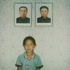 Polaroïd of a North Korean girl posing below the portraits of the Dear Leaders inside her home, South Pyongan Province, Chonsam Cooperative Farm, North Korea (Eric Lafforgue) Tags: 39 asia asianethnicity child childhood children childrenonly communism dictator dictatorship dprk girl girls happiness home house humanbeing indoors innocence kimilsung kimjongil lifestyles lookingatcamera nampho nampo nkorea1543 northkorea northkorean officialportraits onegirlonly oneperson portrait smile southpyonganprovince squarepicture youth chonsamcooperativefarm 北朝鮮 북한 朝鮮民主主義人民共和国 조선 coreadelnorte coréedunord coréiadonorte coreiadonorte 조선민주주의인민공화국 เกาหลีเหนือ קוריאההצפונית koreapółnocna koreautara kuzeykore nordkorea північнакорея севернакореја севернакорея severníkorea βόρειακορέα