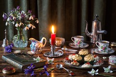 Coffee and Cupcakes. (memoryweaver) Tags: baking tabletop stilllife memoryweaver irises flowers snowdrops cups candlelight candle chamberstick candlestick miniature cupcakes coffee