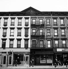 on 10th Avenue (V-A-B) Tags: blackwhite analog film ilfordfp4 rodinal rolleocordvb manhattan newyorkcity 10thavenue architecture buildings storefronts