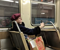 Dedicated selfie-taker (yooperann) Tags: cta chicago transit authority instagram fashion blogger red beret selfie cell phone posing young woman blue line subway el