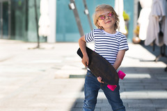 Pretty little boy on a skate board. Emotional kid outdoors. Cute child skating wearing sunglasses. (elenachukhil) Tags: boy child kid skateboard skate outdoors emotional pretty little cute son havingfun outside strippedshirt sunglasses summer spring happy happiness childhood adorable very blond longhair human people spendingtime leisure joy male jeans hobby expression fun youth sport roller smile enjoy ride person white skater cheerful caucasian active
