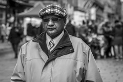 The Cap Fits (Leanne Boulton) Tags: portrait people hat urban street candid portraiture streetphotography candidstreetphotography candidportrait streetportrait streetlife eyecontact candideyecontact man male face expression eyes glasses cap smart tie mood tone texture detail depthoffield bokeh naturallight outdoor light shade city scene human life living humanity society culture canon canon5d 5dmarkiii 70mm character ef2470mmf28liiusm black white blackwhite bw mono blackandwhite monochrome glasgow scotland uk