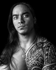 Hawaiian Pride (JoshuaDavis1996) Tags: portrait black white blackandwhite studioportrait sonya7ii portraitphotography zeiss5518 tribal polynesian hawaiian oahu tribaltattoos eyes
