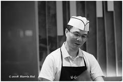 Do You Like Your Work? - Richmond Centre XT5270e (Harris Hui (in search of light)) Tags: harrishui fujixt1 digitalmirrorlesscamera fuji fujifilm vancouver richmond bc canada vancouverdslrshooter mirrorless fujixambassador xt1 fujixcamera fujixseries fujix fuji56mmf12 fujiprimelens fixedlens people portrait chef work job career candid street streetphotography foodcourt shoppingmall bw blackwhite monochrome