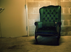 electric-chair (kaumpphoto) Tags: chair mamiya 120 minneapolis basement cinderblock green furniture upholstery tack button plush discarded torn door handle hinge seat sit