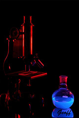 Tonic water and a UV light. (gwhiteway) Tags: study experiment education college university compounds fluorescent fluorescence ultraviolet electrons excited glassware colors biology flask glass red blue background microscope glow dark gels microbiology luminescence coldbody radiation tonic water science chemicals black light uv chemistry abstract mixture solution liquid colorful poison toxic