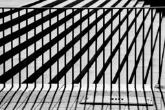 Organized Confusion (Thomas Listl) Tags: thomaslistl blackandwhite biancoenegro noiretblanc graphical geometry fence hff light shadows contrast analog filmphotography minolta ilford hp5 lines diagonal stripes pattern