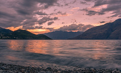 Watching the Sunset over Lake Wakatipu, South Island New Zealand (christaff1010) Tags: d750 landscape sunset water wakatipu nz clouds longexposure summer newzealand hills green lake sun sky lakewakatipu mountains sunlight southisland panorama