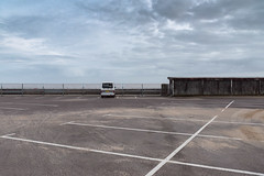 Pier Car Park (Number Johnny 5) Tags: horizon lines tamron d750 nikon pier dull vertical space van clouds sky mundane grim minivan imanoot angles banal 2470mm car patterns deserted park shelter documenting johnpettigrew seaside