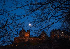 Moonlight over the castle (rustyruth1959) Tags: nikon nikond5600 tamron16300mm uk scotland edinburgh city castle edinburghcastle fortification twilight moonlight moon trees castlerock outdoor building structure fortress windows historicscotland chimneys branches