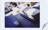 Fujitiva_X (Robert Olaf) Tags: fujitivasfujipolaroidbyncolorinstafujifuji fujitivasfujipolaroidbyncolorinstafujifujiretrato fujitiva fujitivas polaroid retrato instafuji fuji insta fujifilm fujifilminstax mini paper grain color graveyard snow tombs fujifilminstaxmini90