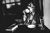 tea time (matthias hämmerly) Tags: woman portrait street monochrom dark black white bw people shadow drink girl window bar blackandwhite streetphotography book restaurant zurich zuerich swiss switzerland