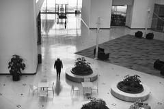 Capitol Square - 14/100 X (mfhiatt) Tags: dscf27930218jpg blackandwhite desmoines iowa oof outoffocus capitolsquare atrium reflection 100xthe2018edition 100x2018 image14100 fuji nd ndfilter fujix100s neutraldensity