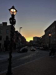 Fells Point ~ sun setting on Thames Street (karma (Karen)) Tags: baltimore maryland fellspoint thamesst cobblestonestreet lampposts decorations lights sunset iphone topf25