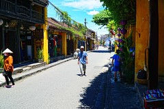 A street in Hoi An, Vietnam (adamba100) Tags: asia asian china chinese korea korean mongolia mongolian vietnam vietnamese thai beijing town city view landscape cityscape street life lifestyle style people human person man men woman women male female girl boy child children kid interesting portrait innocent cute charm pretty beauty beautiful innocence play face headshot pure purity tourism sightseeing tourist travel trip light color colour outdoor traditional cambodia cambodian phnom penh sony a6300 18105 siem reap pattaya bangkok field gate architecture tree building