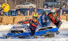 Neck 'n' Neck (Wes Iversen) Tags: michigan nikkor80400mm stcharles bales cars haybales helmets ice men people racing snow snowmobileracing snowmobiles spectators suits vintage winter