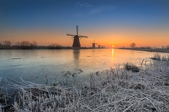 Cold sunrise in Kinderdijk (CG@Photography) Tags: kinderdijk sunrise cold winter landscape landmark water ice tourism travel touristic holland netherlands nederland nature orange outdoors unesco