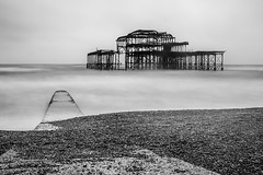 Brighton West Pier (ed027) Tags: ifttt 500px fire line city sea winter water beach stones building black white calm pier wood peaceful seascape long stone abandoned blur exposure seaside seashore waterfront architectural structure smooth mono derelict burnt remains