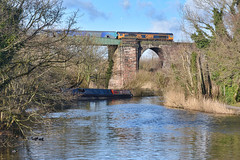 The Sun Came Out (whosoever2) Tags: uk united kingdom gb great britain nikon d7100 train railway railroad february 2018 gbrf class66 66705 golden jubilee river weaver northwich 6e10 viaduct biomass liverpool drax duck barge boat