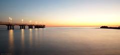Blue hour in Marina di Massa (Darea62) Tags: sunset sea longexposure bridge bluehour tuscany marinadimassa toscana seascape skyscape streetlights pier jetty tramonto travel