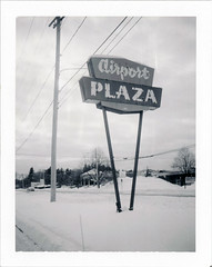Muskegon, MI (moominsean) Tags: polaroid 190 instant type664 expired092009 michigan muskegon airportplaza sign winter snow