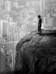 Stands on Suicide Wall (Horizonwalker) Tags: suicidewall hongkong kowloon kowloonpeak peak feingoshan cliff hiking urban city hiker buildings outdoor dangerous risk stone adventure