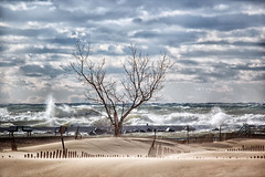 The Gales of November 2017 (Leslie Victor) Tags: waves beach wind sky hollandstatepark hollandmi fence seascape landscape lakemichigan pier img754511