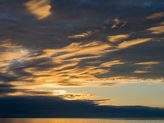 Honey clouds (Alexander-_-Laz) Tags: baikal russia sun sunset evening dim light horizon water sky overcast cloud orange blue gloom reflection