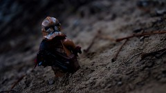 Within the wasteland (RagingPhotography) Tags: lego star wars geonosis wasteland waste land outside outdoors outdoor dirt filth filthy mess rock rocks rocky night dark alone lone lonely clone trooper clonetrooper republic war custom minifigure figure minifig plastic toy toys ragingphotography