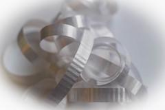 RIBBONS (abbigail may) Tags: ribbons macromondays monochrome white highkey curls nikon