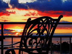 A magical sunset (peggyhr) Tags: peggyhr chair railing balcony sunset ocean sun clouds mauve red orange yellow white blue black pink dsc06386a hawaii silhouettes thegalaxy thegalaxystars thelooklevel1red thelooklevel2yellow thegalaxylevel2 thegalaxyhalloffame09 infinitexposurel1
