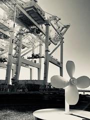 Port of Oakland (Melinda Young Stuart) Tags: urban harbor sculpture publicart westcoast shipping industry crane propeller park oakland port containers