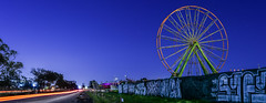 butler's traveling amuesments arrives (pbo31) Tags: bayarea alamedacounty eastbay california night dark color nikon d810 february 2018 winter boury pbo31 purple oakland 66th butler amuesments traveling setup midway fair 880 carnival ferriswheel rides spinninglight panoramic large stitched panorama lightstream motion traffic roadway