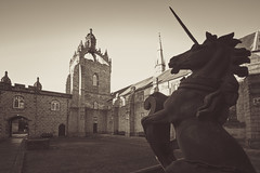 the Aberdeen unicorn rears up against the Kings College quad and chapel, fine art black & white. University of Aberdeen, Aberdeen, Scotland (grumpybaldprof) Tags: universityofaberdeen learning training aberdeen scotland ancient 1495 founded1495 historyhistoriceducationcollege elphinstone bishopelphinstone kings kingscollege new newkings sirduncanricelibrary library granite architecture campus chapel kingschapel quad perspective detail sky clouds architect schmidthammerlassen recliningstudent artist statue bronze students kennyhunter instituteofmedicalsciences rowettinstituteofnutritionhealth buildings details waterlines willmaclean marianleven cromwellstower canon 7d canon7d sigma 1020 1020mm f456 sigma1020mmf456dchsm wideangle ultrawide