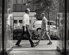 urban striders (-liyen-) Tags: men woman walkingcity urban toronto bw candid street streetshot framed 3 three fujix100f blackandwhite ontario canada matchpointwinner mpt610 challengeyouwinner cyunanimous