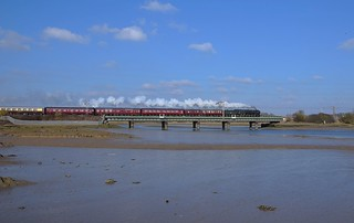 Standard Class 7 No.70013 'Oliver Cromwell' storms across the Stour Estuary at Cattawade (Manningtree) with 1Z90, Liverpool Street - Norwich Cathedrals Express. 22 02 2018