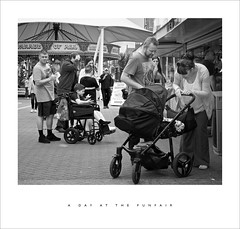 A day at the funfair (Parallax Corporation) Tags: sonya7r2 sonyfe85f18 blackandwhite funfare southport holidaymakers candles streetphotography pram parents seaside wheelchair icecream mother father