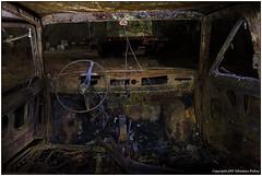 Contemporary interior design (seb a.k.a. panq) Tags: nightphotography urbex abandoned sebastianbakajphotography lightpainting lp burned metal interior vehicle steeringwheel fiat126p vandalism