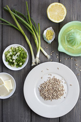 Plate of uncooked farro grains with onions, lemons, butter and rind as ingredients for a recipe (Transient Eternal) Tags: farro spelt grain wheat barley nutritious nutrition healthyfood rice gourmet cuisine meal dinner lunch onions lemon lemonjuice butter plate ceramicplate vintage tabletop rustic rawingredients ingreidient savory food foodpreparation rind lemonrind kernels scallions cooking cook diet healthydiet foodprep serving goodfood dish fruit vegetables dairy bulgur oatmeal fiber raw