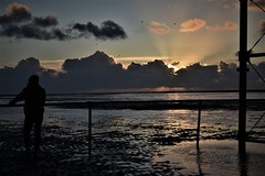 Sunset in Southport (M Cavendish) Tags: southport merseyside pier beach clouds sunset winter dark sea reflections nikond3400 coast water ocean sky silhouette moody
