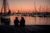 Harbour sunset.... (Dafydd Penguin) Tags: harbour port harbor dock harbourside waterside water sea yachts yachting sail boat sailboat sun twilight sunset quay mooring pontoon reflections orange colour people candid couple romance barcelona vell catalunya catalonia spain leica m10 summicronm 35mm f2 summicron lens
