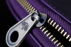 Zip It (Patrick JC) Tags: macromondays fasteners zip bag purple teeth open curve