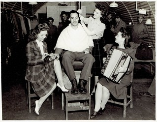 USO Performers Giving a Haircut, GI Barber Shop, Somewhere in England, 1943