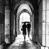 Beautiful Rain (DobingDesign) Tags: blackandwhite walking couple together london arches historiclondon stone texture rainy wet umbrella handbag woman weather lightandshadow people architecture archway doorway walkway strolling stroll tranquility elegance