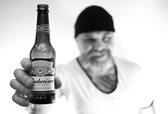 Bottle of Bud. . . (CWhatPhotos) Tags: tattoo tattooed tattoos bottle beer goatee photographs photograph pics pictures pic picture image images foto fotos photography cwhatphotos that have which with contain mk digital camera lens micro four thirds em5 ii me man male self portrait selfee selfie mine face dark shadow light studio lights shadows hairy tash tach mustache big hair long chin budweiser black white mono drink lager red label dof bokeh depth field f18