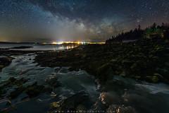 Milky Way Over Lubec (Adam Woodworth) Tags: astrophotography downeast ice johnsonbay lightpollution lowtide lubec maine milkyway newengland night seaweed stars town winter