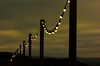 Chain,chain,chain......chain of light. (alex.vangroningen) Tags: lights poles sky clouds bokeh dof northwales