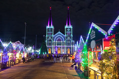 Christmas Stalls with colorful light in front of the Cathedral. (baddoguy) Tags: ancient civilization architecture audience building exterior built structure christmas market color image cultures dark dusk electricity event famous place footpath happiness holiday horizontal igniting illuminated joy stall multi colored night no people photography religion religious celebration sky thai culture thailand tourism town square travel destinations vacations village