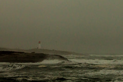 A Beacon in the Fog (langdon10) Tags: atlanticocean canada canon70d lighthouse novascotia peggyscove shoreline storm surf ocean outdoors waves winter