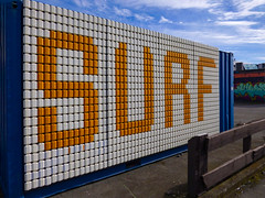 Surf (Steve Taylor (Photography)) Tags: surf art mural streetart container blue orange white newzealand nz southisland canterbury christchurch newbrighton sky cloud
